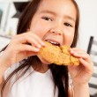 Young Girl Eating Cookie — Stock Photo #7285635
