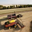 Harvester with Grain Cart - Stock Photo