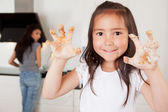 Child with Cookie Dough on Hands — Stock Photo