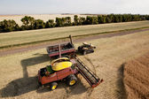 Harvester with Grain Cart — Stock Photo