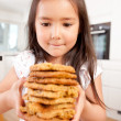 Young Girl with Homemade Cookies - Stock Photo