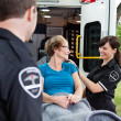 Happy Woman on Ambulance - Stockfoto