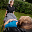 Female Paramedic Pulling Stretcher — Stock Photo #7335094