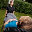 Female Paramedic Pulling Stretcher - Stock Photo