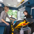 Foto Stock: Elderly Woman in Ambulance