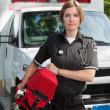 EMS Professional Woman with Oxygen Unit - Stock Photo