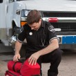 Stock Photo: Male Paramedic with Oxygen Unit