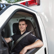 Paramedic Portrait Driving Ambulance - Stock Photo