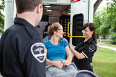 Happy Woman on Ambulance — Stockfoto