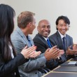 Royalty-Free Stock Photo: Professionals applauding during a business meeting