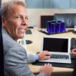 Mature man using laptop in office — Stock Photo #7356713