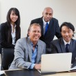 Portrait of multi ethnic business - Stock Photo