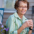 Senior Woman with Warm Drink Outdoors — Stock Photo #7359946