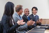 Professionals applauding during a business meeting — Stock Photo