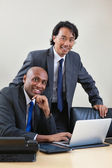 Businessmen working on laptop — Stock Photo