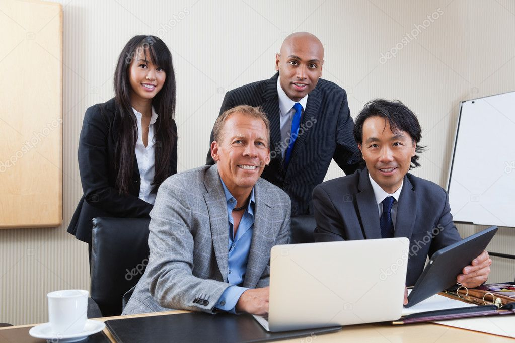Portrait of multi ethnic businesspeople in office — Stock Photo #7359081