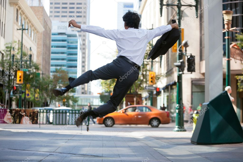 Rear view of business man jumping in air and kicking heals — Stock Photo #7359455
