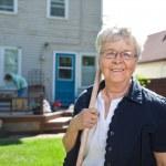 Senior woman holding gardening tool — Stock Photo #7360182