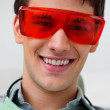 Handsome dentist wearing protective eyewear — Stock Photo