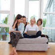 Female friends using laptop — Stock Photo