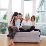Female friends using laptop — Stock Photo