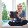 Young female holding tablet pc — Stock Photo
