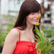 Woman smelling flower - Foto Stock