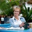 Senior Woman Cashier in Garden Center — Stock Photo