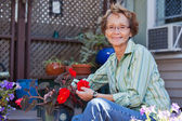 Senior woman with potted plant — Stock Photo