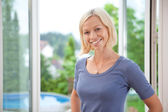 Pretty young woman smiling — Stock Photo