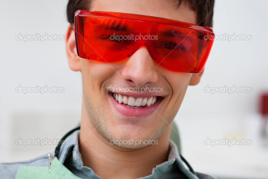 Portrait of dental patient wearing protective eyewear — Stock Photo #7364434