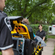 Ambulance Workers with Patient - Stock Photo