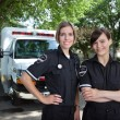 Female Paramedic with Ambulance — Stock Photo