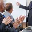 Business applauding during presentation - Stock Photo