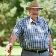 Senior man standing in park — Stock Photo