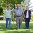 Senior Friends Walking in Park — Stock Photo #7405275