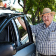 Stock Photo: Portrait of Senior Mwith Car