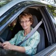 Stock Photo: Senior womdriving car