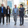 Stock Photo: Business walking together on street