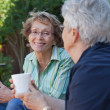 Senior Women with Warm Drinks — Stock Photo