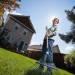 Woman holding rake — Stock Photo