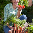 Woman in Garden Picknig Vegetables — Stock Photo