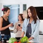 Female friends in kitchen — Stock Photo