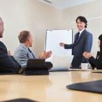 Man giving a presentation to associates — Stock Photo
