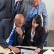 Business team working on laptop together — Stock Photo