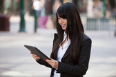 Businesswoman using tablet pc — Stock Photo