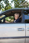 Pretty senior woman driving car — Stock Photo