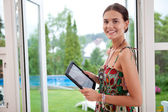 Woman holding tablet pc — Stock Photo