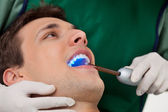 Dentist with UV Light — Stock Photo