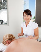 Acupuncturist Using Plum Blossom Tool — Stock Photo